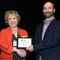 Kathryn Lilley being presented with the HUPO Award for Distinguished Achievement in Proteomic Sciences.