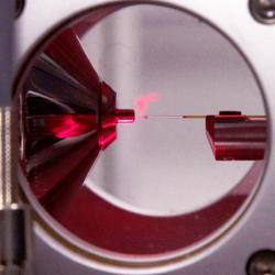 Gas-phase ions being generated in a nano-electrospray ion source.