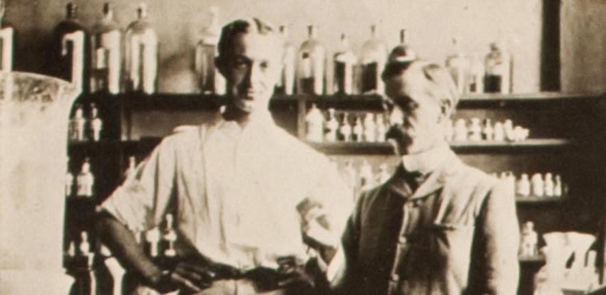 S.W. Cole and F.G. Hopkins with the first specimen of tryptophan, 1901